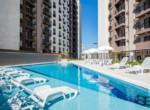 apartamento-living-choice-joao-pinheiro-foto-da-piscina-recreativa-e-deck-molhado-1605x720- 01